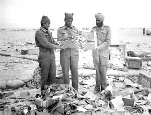 Indian soldiers holding a Nazi flag after Libyan Omar was taken by Indian troops